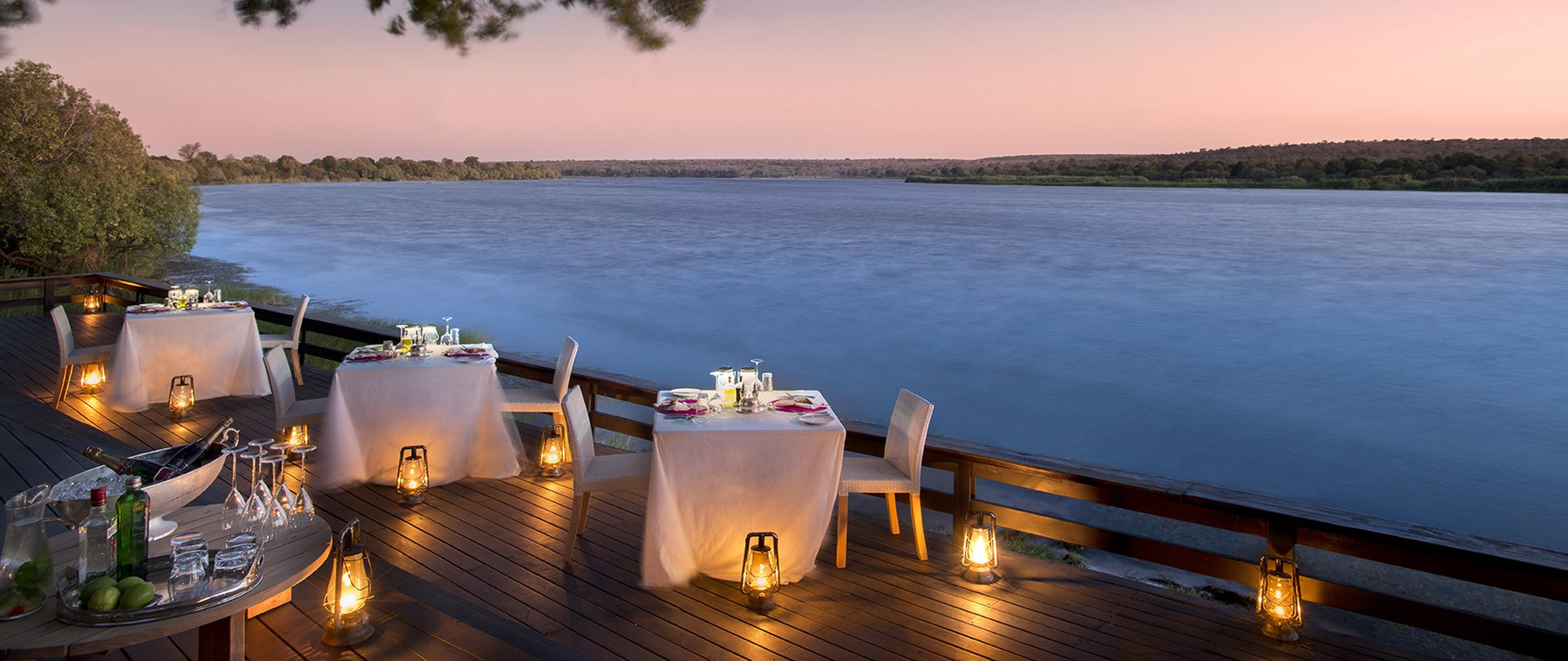 Romantic candlelit dining at Royal Chundu River Lodge in Zambia